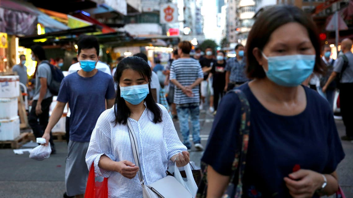 FILE PHOTO: People wear surgical masks at a wet market following the coronavirus disease (COVID-19) outbreak at Sham Shui Po, one of the oldest districts in Hong Kong, China July 17, 2020. REUTERS/Tyrone Siu/File Photo