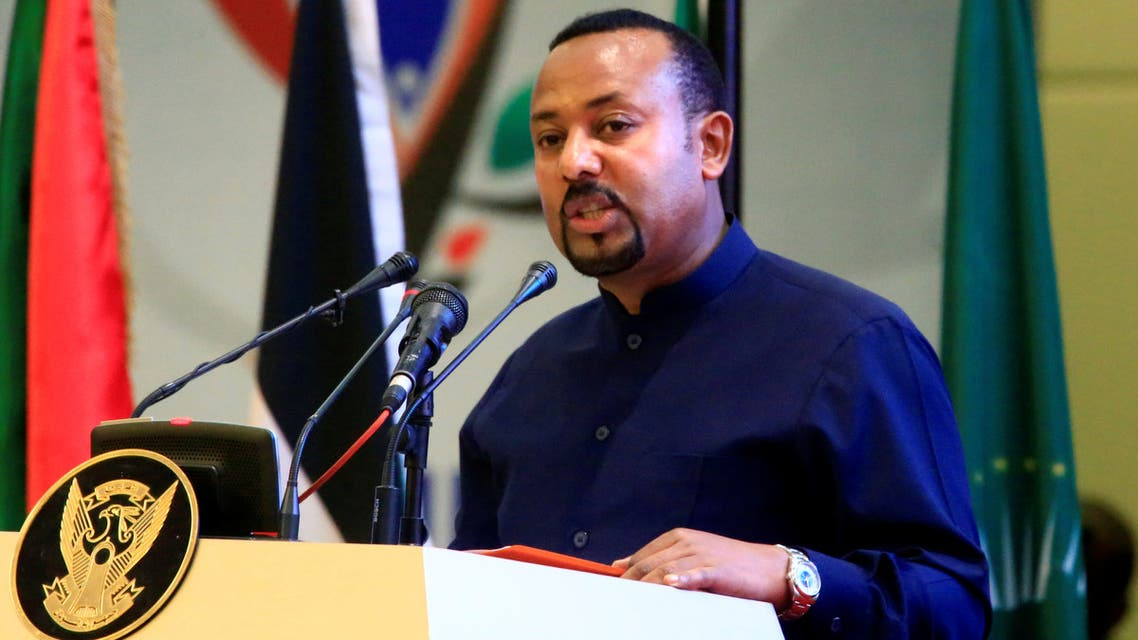 Ethiopia's Prime Minister Abiy Ahmed addresses delegates during the signing of the Sudan's power sharing deal, that paves the way for a transitional government, and eventual elections, following the overthrow of a long-time leader Omar al-Bashir, in Khartoum, Sudan, August 17, 2019. REUTERS/Mohamed Nureldin Abdallah