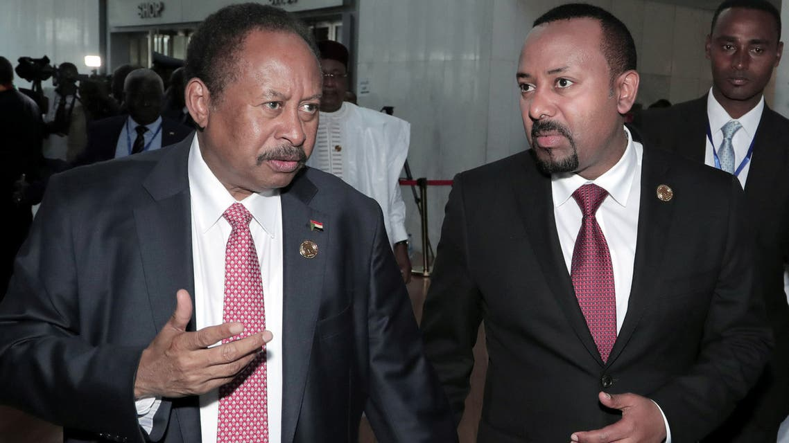 Sudan's PM Abdalla Hamdok and Ethiopia's PM Abiy Ahmed arrive together to attend a meeting of the African Union (AU) in Addis Ababa, Ethiopia, February 9, 2020. (Reuters/Tiksa Negeri)