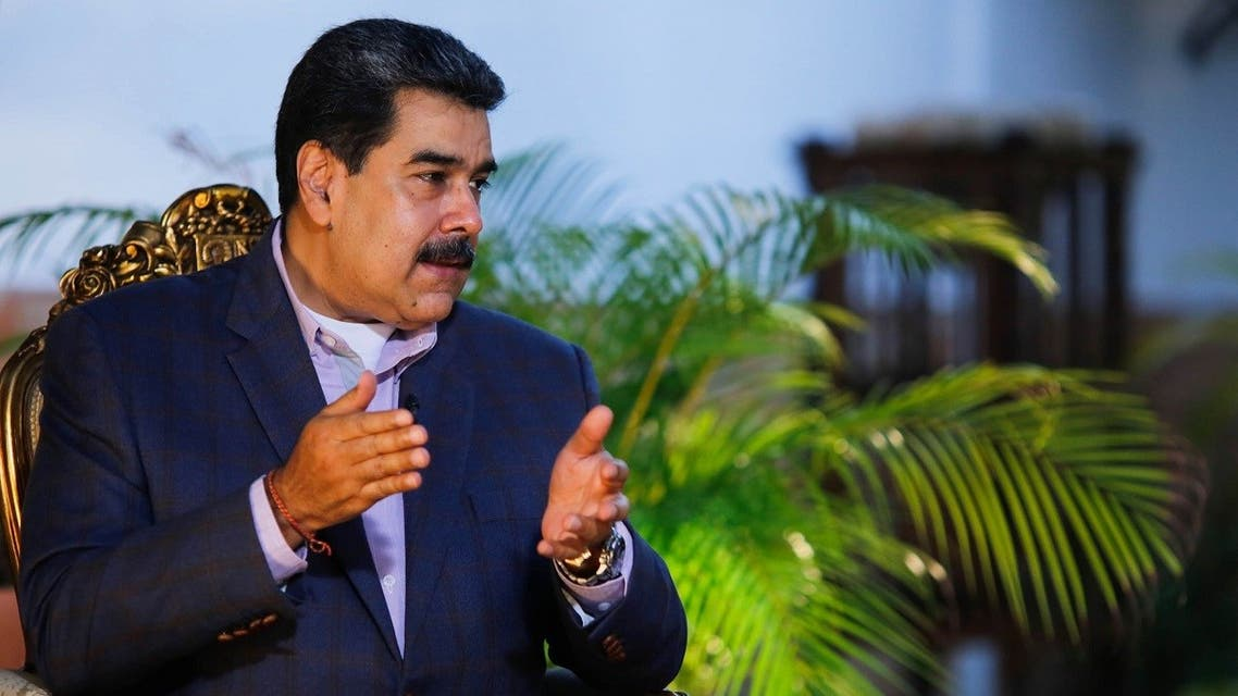 Handout picture released by the Venezuelan Presidency showing President Maduro during an interview with the Venezuelan journalist Ernesto Villegas, in Caracas, August 23, 2020. (AFP/Venezuela's Presidency/Jhonn Zerpa)
