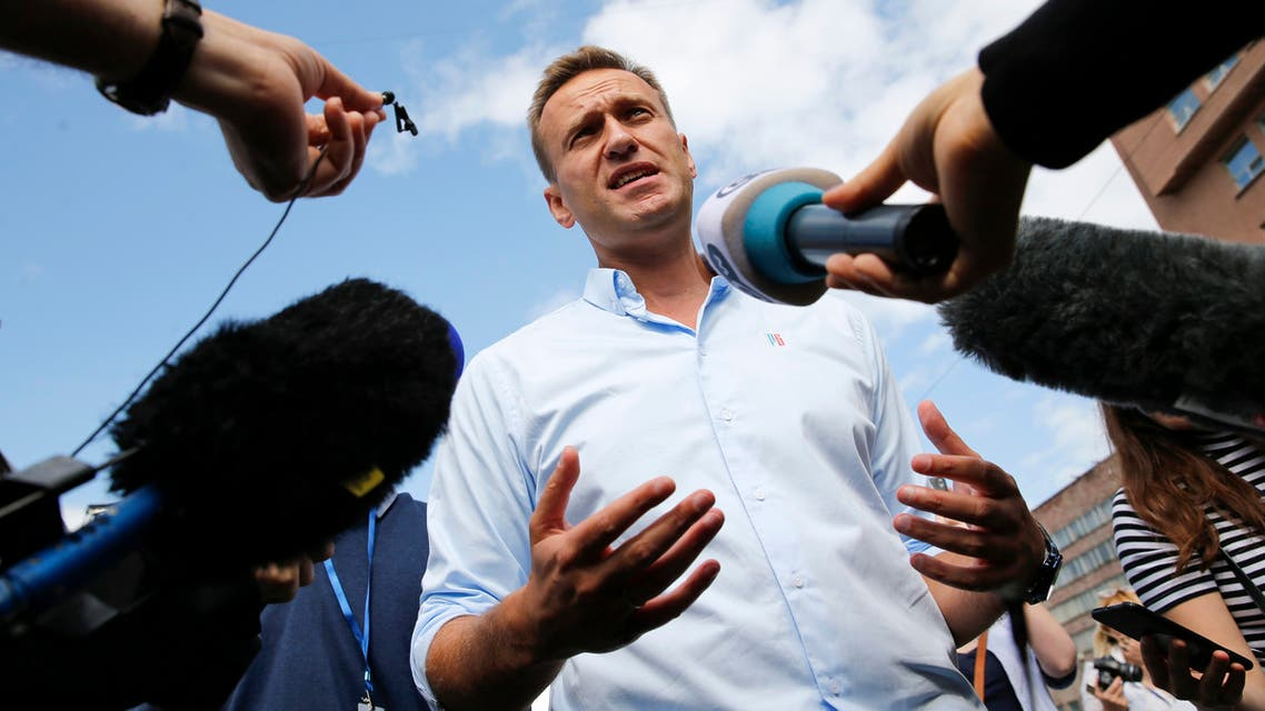 (FILES) In this file photo taken on July 20, 2019 Russian opposition leader Alexei Navalny speaks with journalists during a rally to support opposition and independent candidates after authorities refused to register them for September elections to the Moscow City Duma, Moscow. The Russian opposition leader Alexei Navalny was in intensive care in a Siberian hospital on August 20, 2020 after he fell ill in what his spokeswoman said was a suspected poisoning.