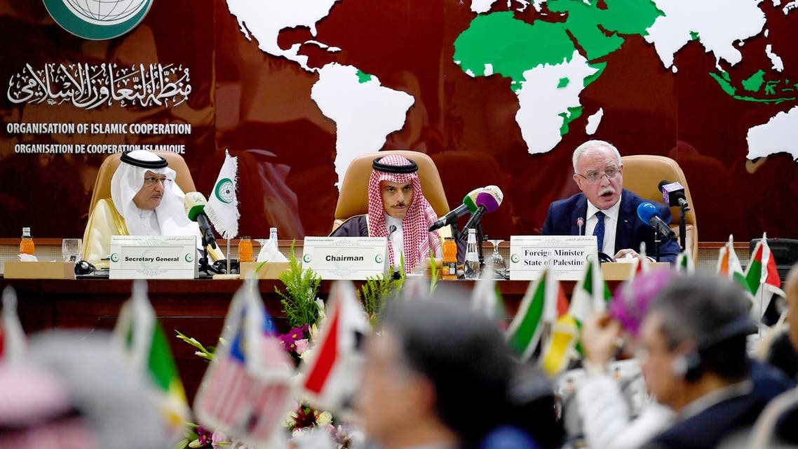 Palestinian Foreign Minster Riyad al-Maliki (R) delivers a speech during an emergency ministerial meeting of the Organisation of Islamic Cooperation (OIC) in Jeddah on February 3, 2020, to address US President Donald Trump's Middle East plan.