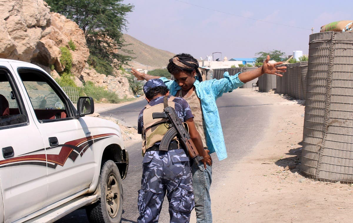 A member of the Yemeni security forces frisks a man at a checkpoint in the former Al-Qaeda in the Arabian Peninsula (AQAP) jihadist's bastion of Mukalla in Yemen's coastal southern Hadramawt province, on November 30, 2018. (AFP)