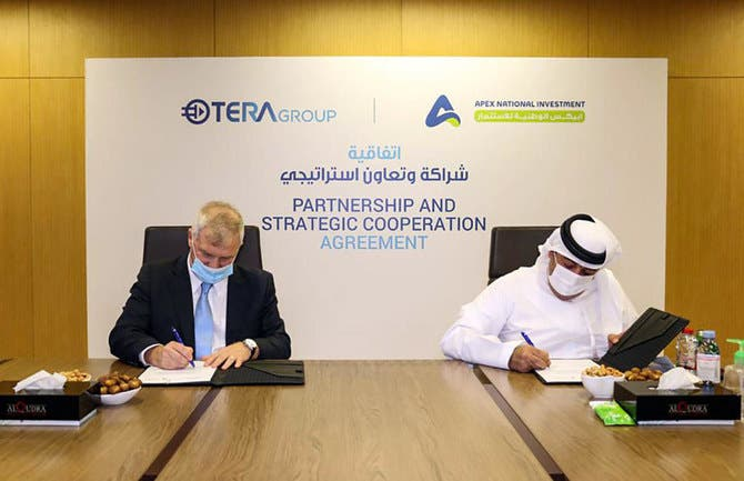 Emirati company APEX National Investment (R) and the Israeli TeraGroup, signing an agreement to develop COVID-19 research, in Abu Dhabi. (WAM)