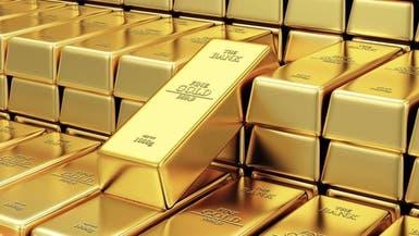 تراجع الدولار يرفع الذهب وسط آمال بشأن تحفيز أميركي