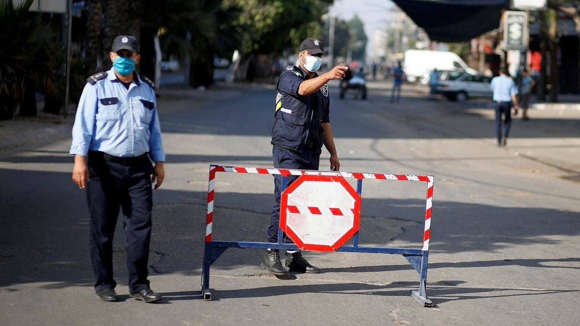 A Palestinian police officer gestures during a lockdown after Gaza reported its first cases of COVID-19 in the general population, in Gaza City August 25, 2020. (Reuters)