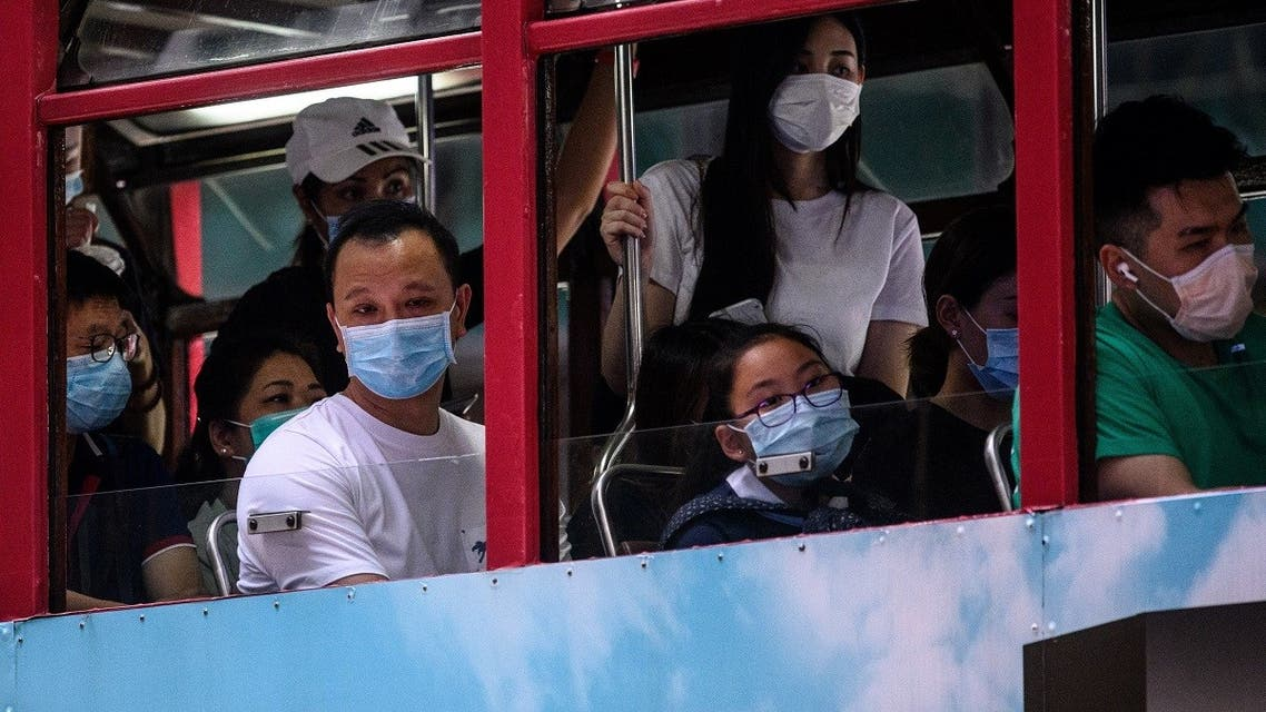 Commuters wear face masks as they travel on the top deck of a tram in Hong Kong. (File photo: AFP)