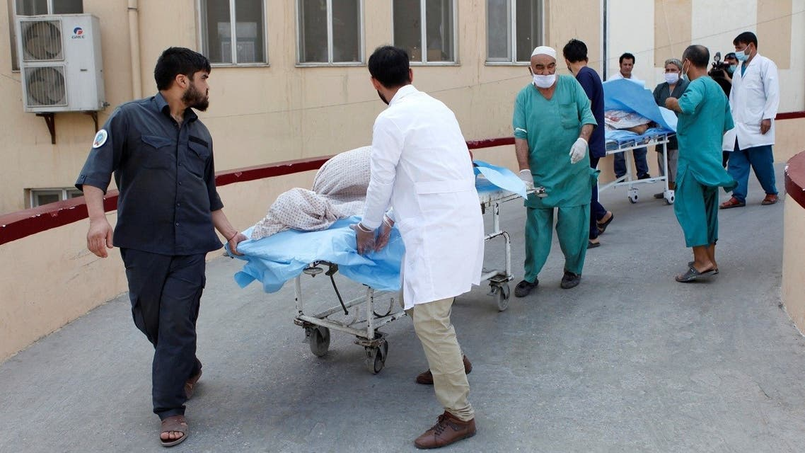 Hospital workers transfer injured people for treatment after a truck bomb blast in Balkh province, in Mazar-i-Sharif, Afghanistan August 25, 2020. (Reuters)