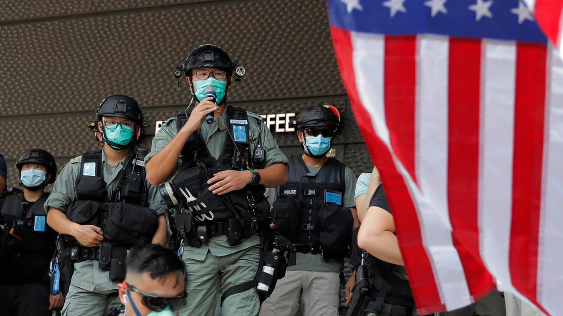 Riot police stand guard in front of an American flag near the U.S. Consulate in Hong Kong, Saturday, July 4, 2020 during the American Independence Day. (File photo: AP)
