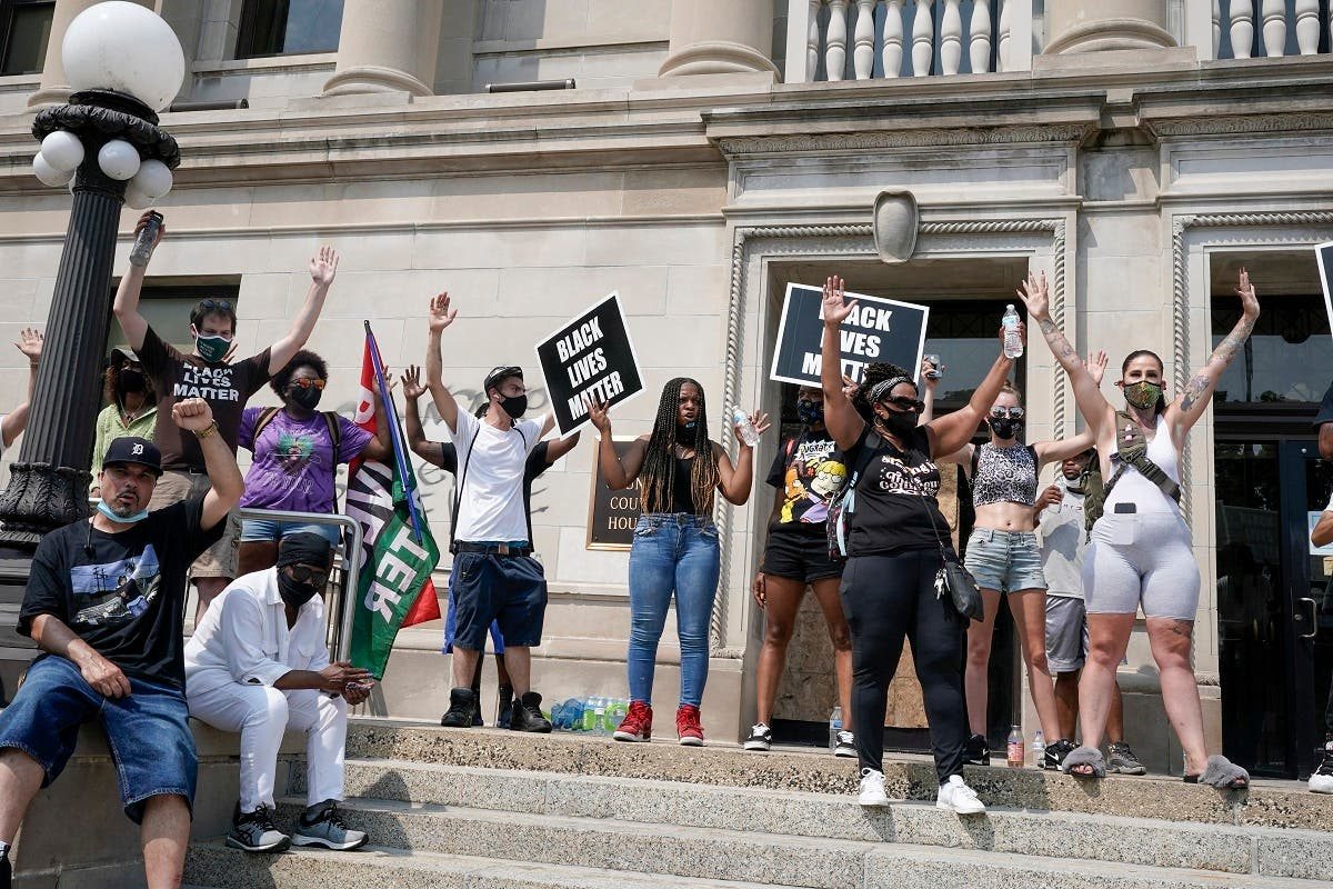 A group of Black Lives Matter protesters hold a rally on the steps of the Kenosha County courthouse, Aug. 24, 2020, in Wisconsin. (AP)