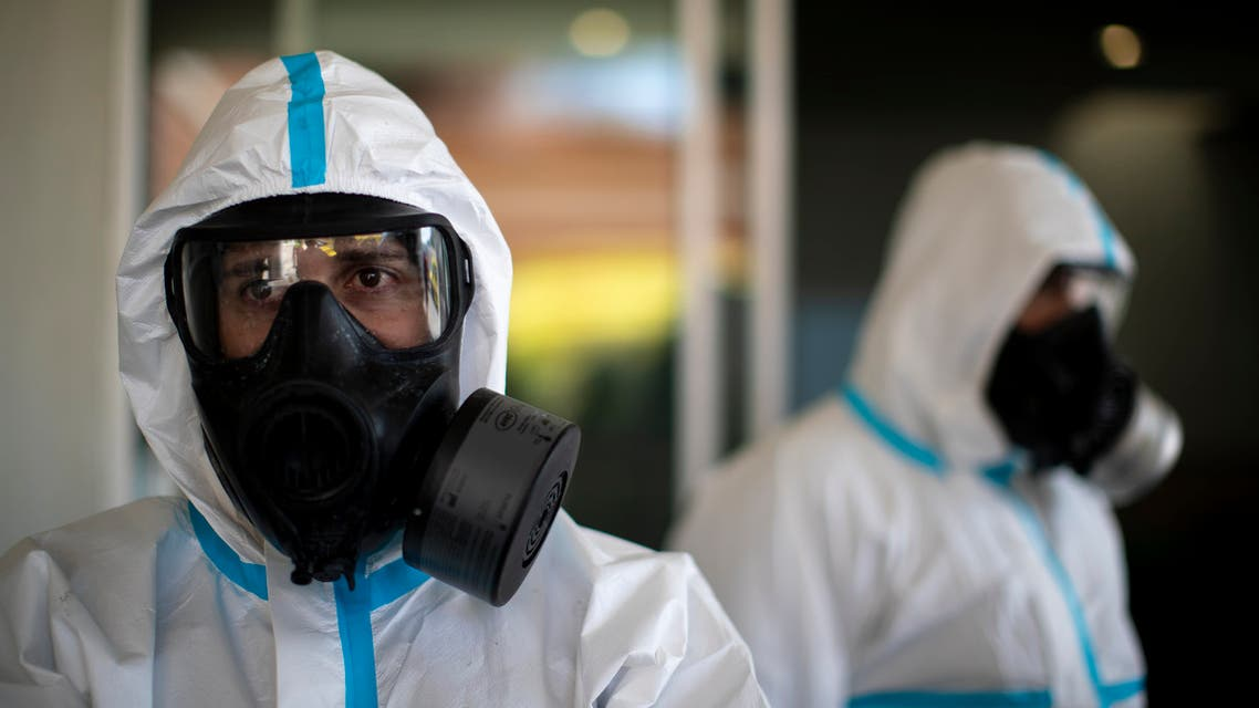 Members of the Emergency Army Unit wearing protective suits to protect from coronavirus prepare to disinfect a hospital in Madrid, Spain, Spain on April 30, 2020. (AP)