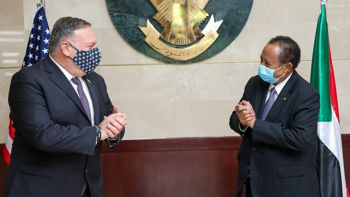 US Secretary of State Mike Pompeo (L) greeting Sudanese Prime Minister Abdalla Hamdok (R) in Khartoum. (AFP)