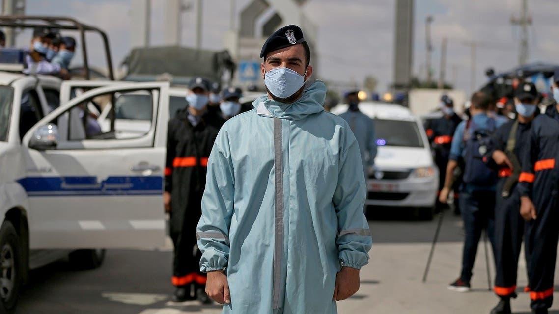 Members of Palestinian Hamas security forces wear protective gear as precaution against the coronavirus disease, at Rafah border crossing, Aug. 11, 2020. (Reuters)