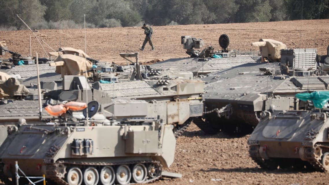 An Israeli soldier walks past military vehicles in a gathering point near the Israel-Gaza Border, Thursday, Nov. 14, 2019. (File photo: AP)