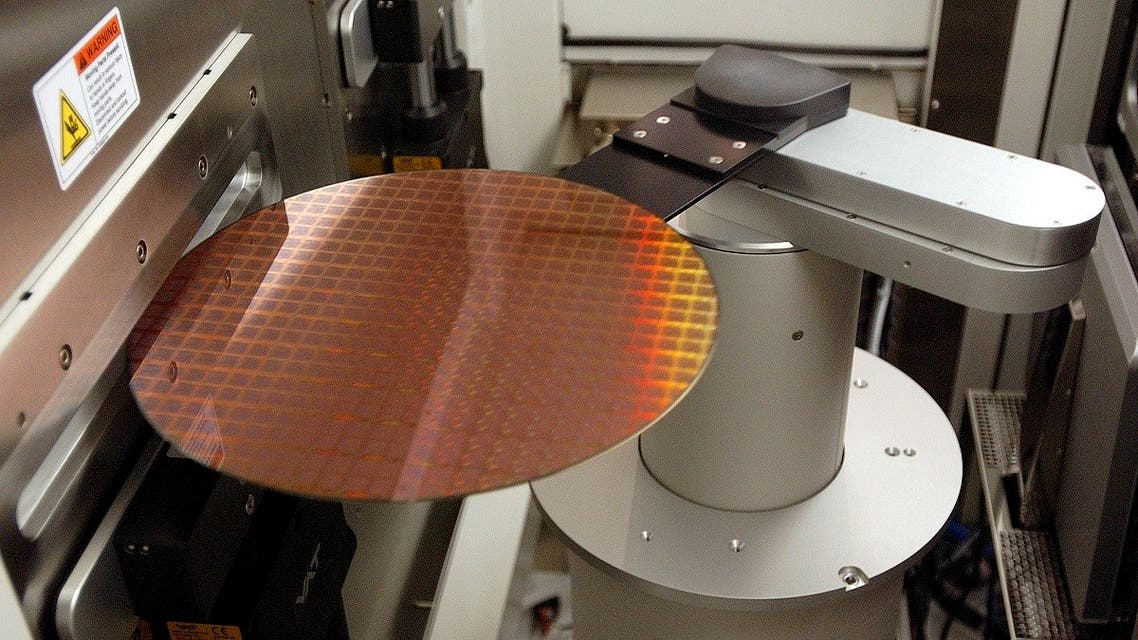 A wafer with hundreds of Power PC microprocessors is loaded into a machine to apply an oxide layer as part of the insulation process at the IBM 300 mm Manufacturing Plant in East Fishkill, New York. (File photo: Reuters)