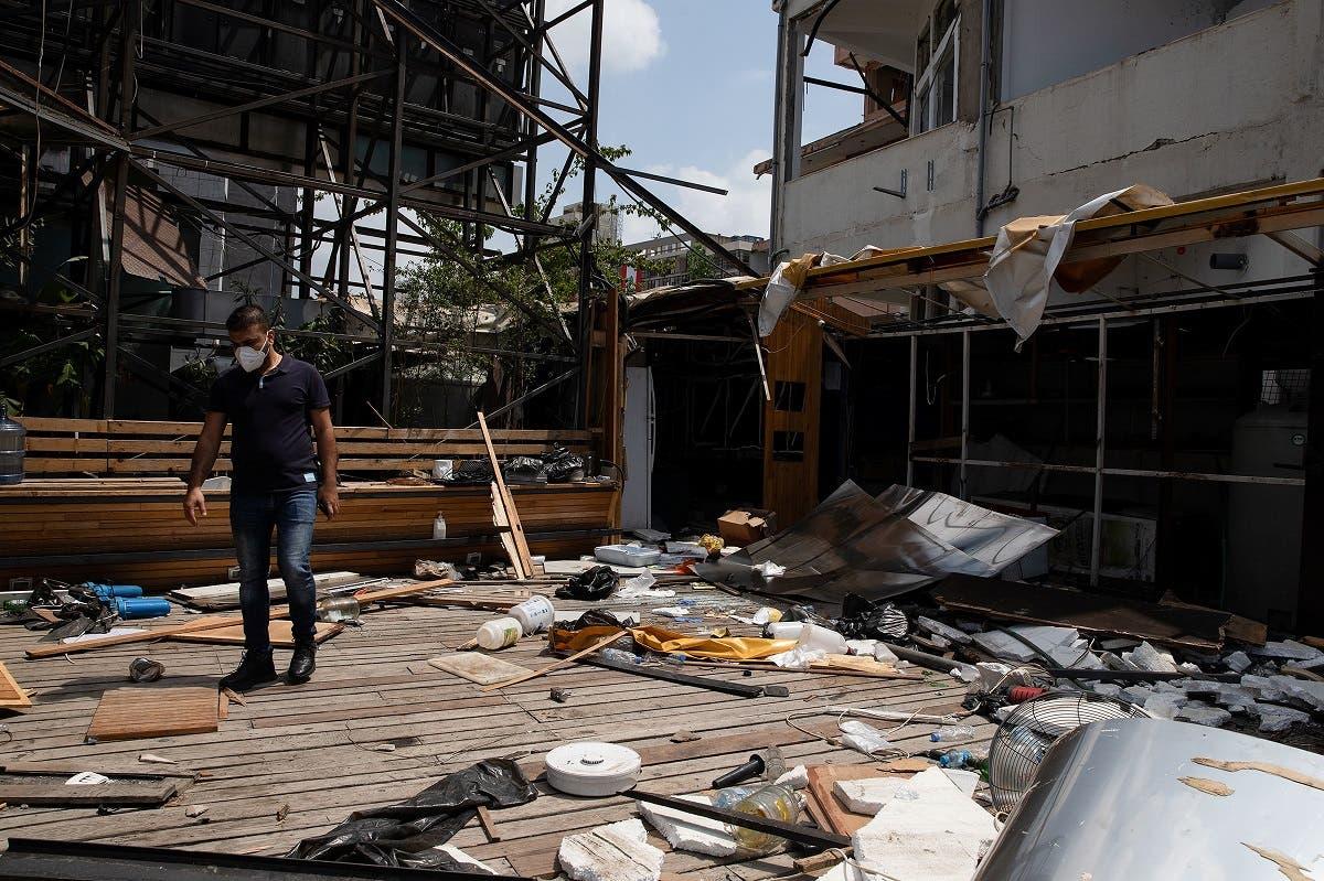 Owner Nazih Dirani walks among debris at the damaged Coup d'Etat bar, in Beirut. (File Photo: Reuters)