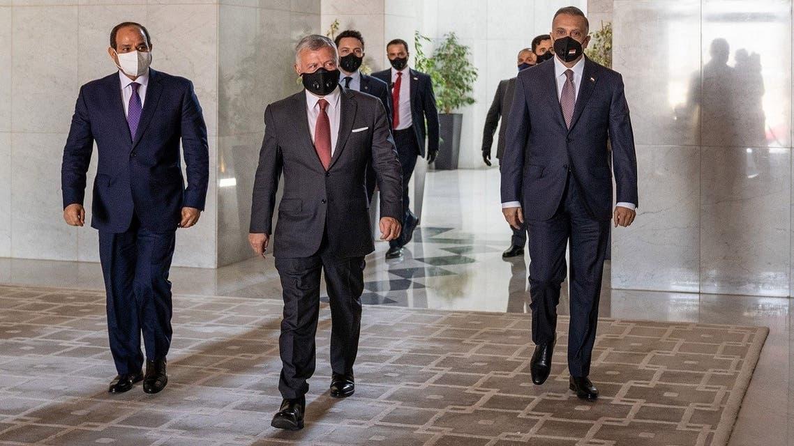 Jordanian King Abdullah II (C) arriving with Egyptian President Abdel Fattah al-Sisi (L) and Iraqi Prime Minister Mustafa al-Kadhemi (R) ahead of the summit in the capital Amman. (AFP)