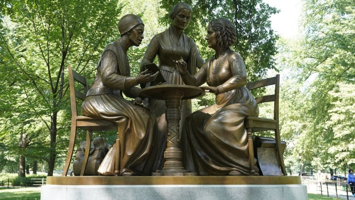 The unveiling of the statue of women's rights pioneers Susan B. Anthony, Elizabeth Cady Stanton and Sojourner Truth is seen in Central Park in New York on August 26, 2020. (AFP)