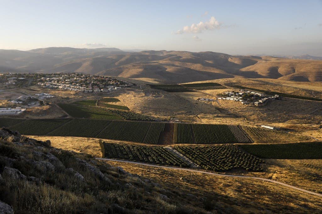 A picture shows the Israeli settlements of Mitzpe Kramim (R) and Kokhav HaShahar (l) in the occupied West Bank on June 18, 2020. (AFP)