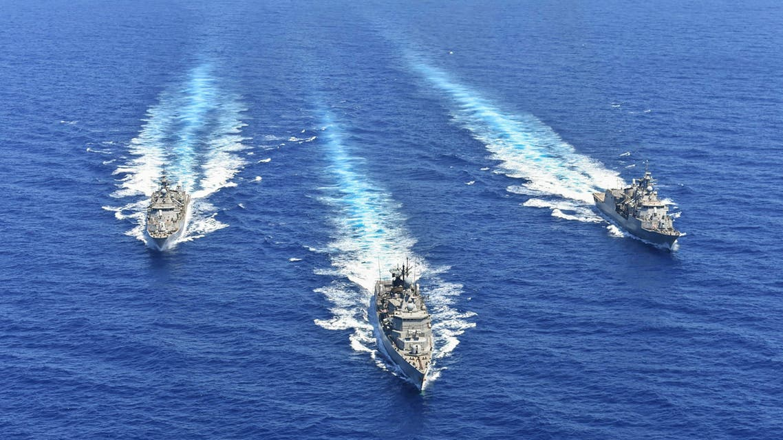 A handout photo released by the Greek National Defence Ministry on August 26, 2020 shows ships of the Hellenic Navy taking part in a military exercise in the eastern Mediterranean Sea, on August 25, 2020. Greece said it will launch military exercises on August 25 with France, Italy and Cyprus in the eastern Mediterranean, the focus of escalating tensions between Athens and Ankara. The joint exercises south of Cyprus and the Greek island of Crete will last three days, the defence ministry said. The discovery of major gas deposits in waters surrounding Crete and Cyprus has triggered a scramble for energy riches and revived old rivalries between NATO members Greece and Turkey.