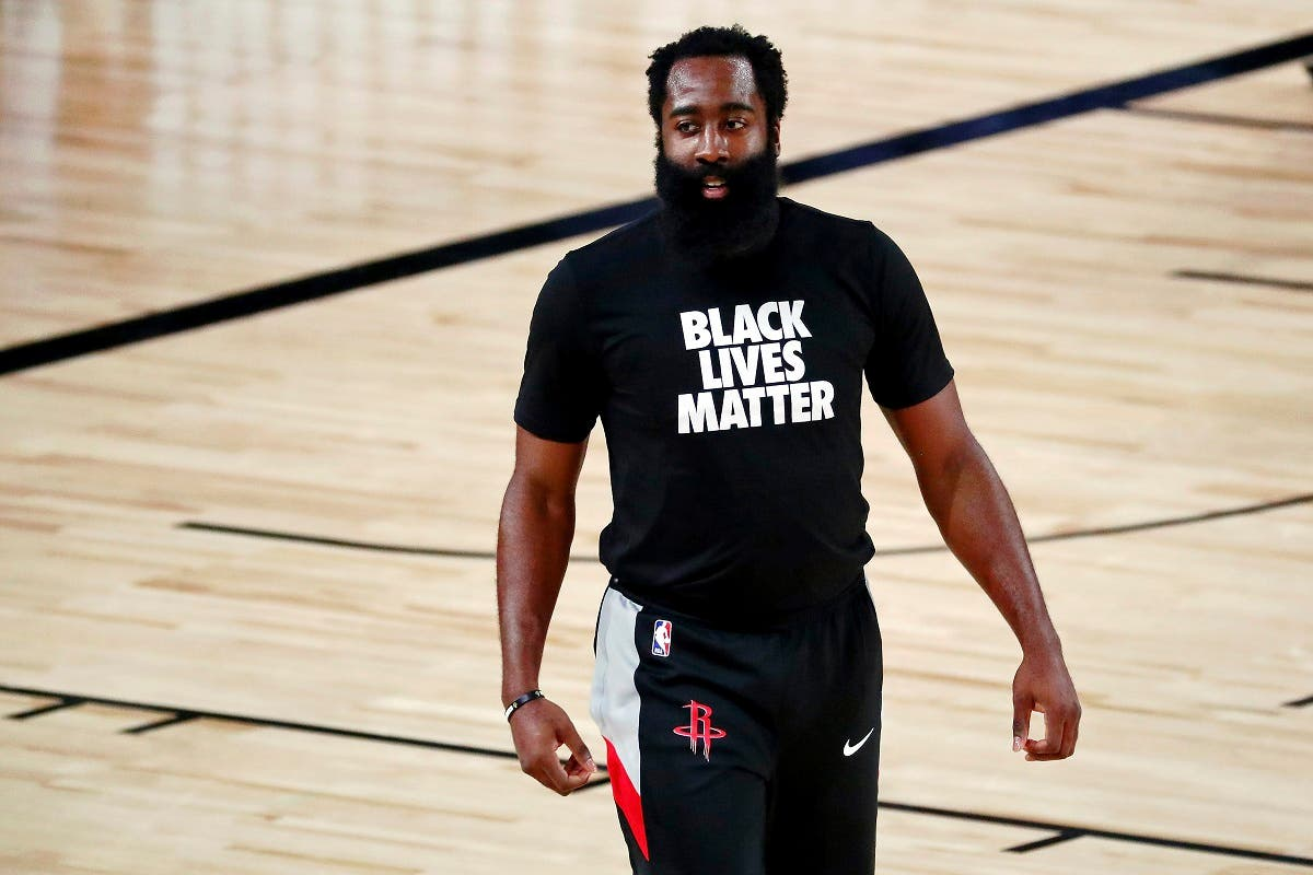 Houston Rockets guard James Harden wears a Black Lives Matter T-shirt during warmups before an NBA game, Aug. 6, 2020, in Florida. (AP)