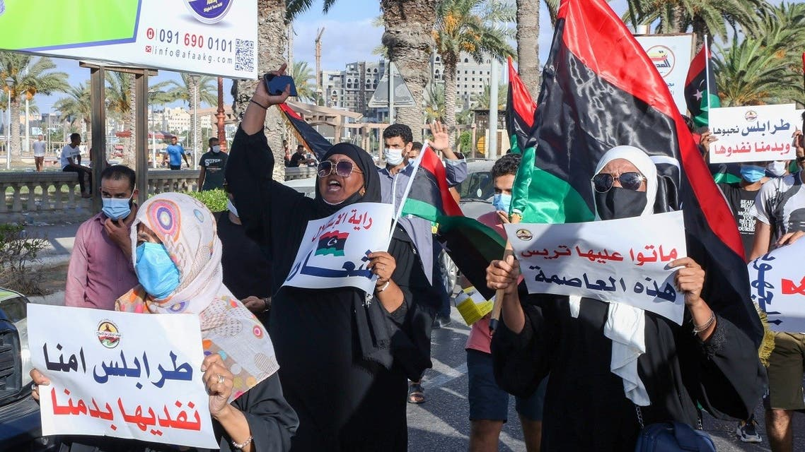 Libyans chant slogans during a demonstration due to poor public services at the Martyrs' Square at the centre of the GNA-held Libyan capital Tripoli on August 25, 2020. (AFP)