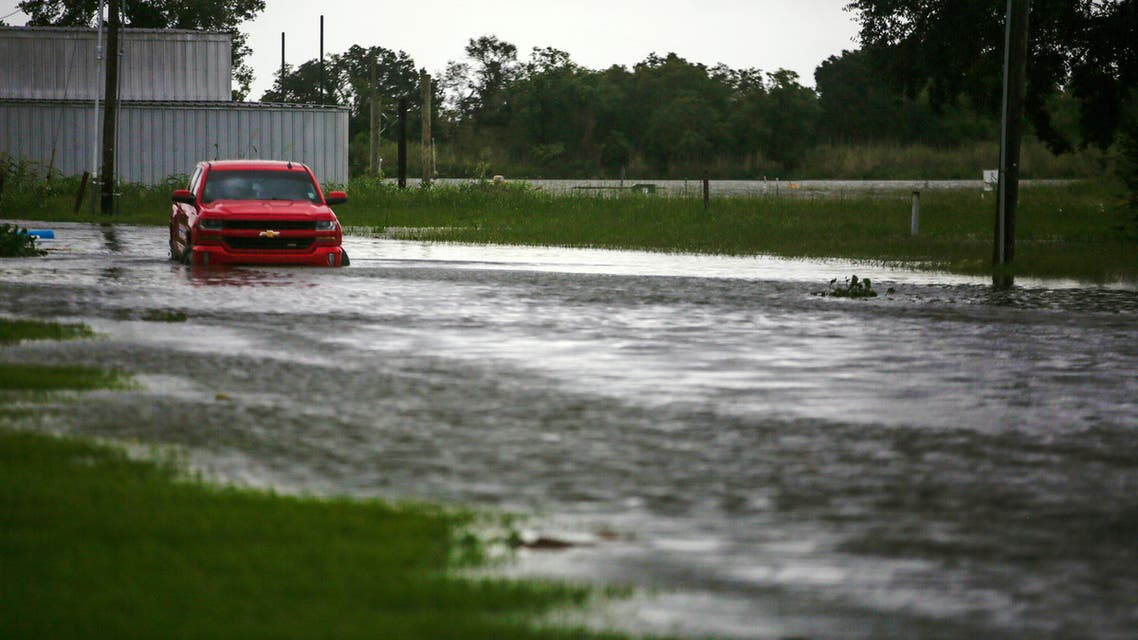 A car near Vermilion Bay is seen partially submerged in waters brought by Hurricane Laura approaching Abbeville, Louisiana, US, August 26, 2020. (Reuters)