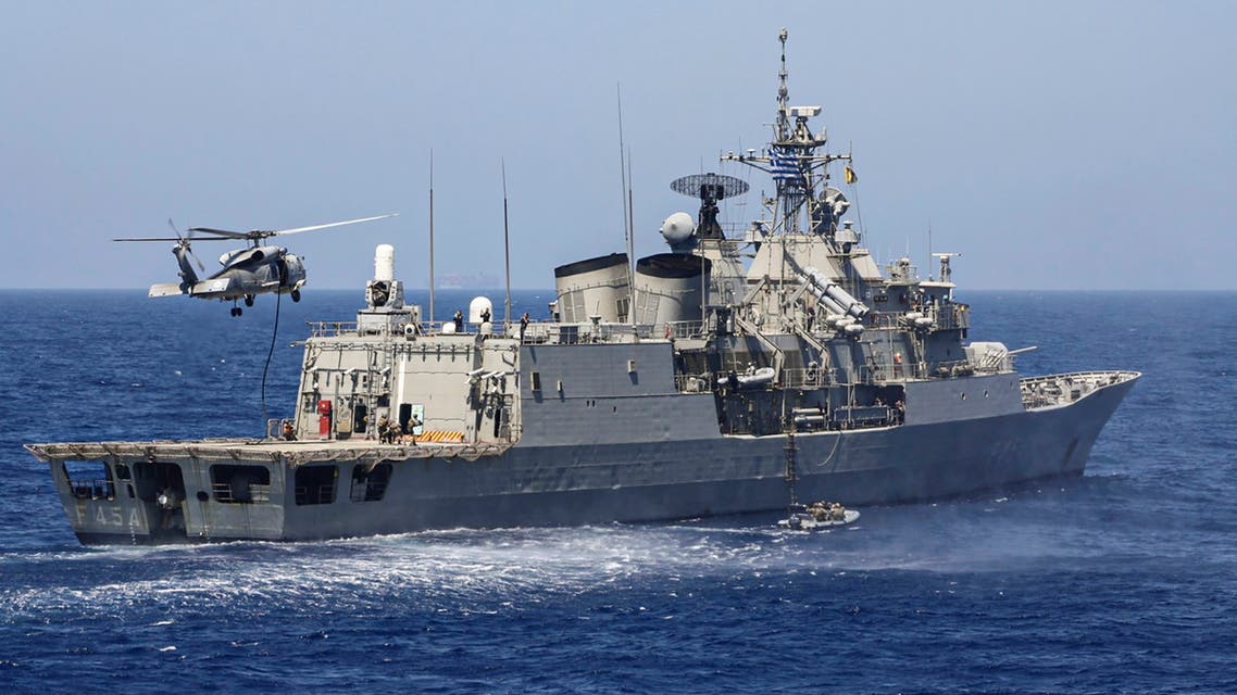 A handout photo released by the Greek National Defence Ministry on August 26, 2020 shows Greek Hydra-class frigate Psara (F-454) of the Hellenic Navy and a military helicopter taking part in a military exercise in the eastern Mediterranean Sea, on August 25, 2020. Greece said it will launch military exercises on August 25 with France, Italy and Cyprus in the eastern Mediterranean, the focus of escalating tensions between Athens and Ankara. The joint exercises south of Cyprus and the Greek island of Crete will last three days, the defence ministry said. The discovery of major gas deposits in waters surrounding Crete and Cyprus has triggered a scramble for energy riches and revived old rivalries between NATO members Greece and Turkey.
