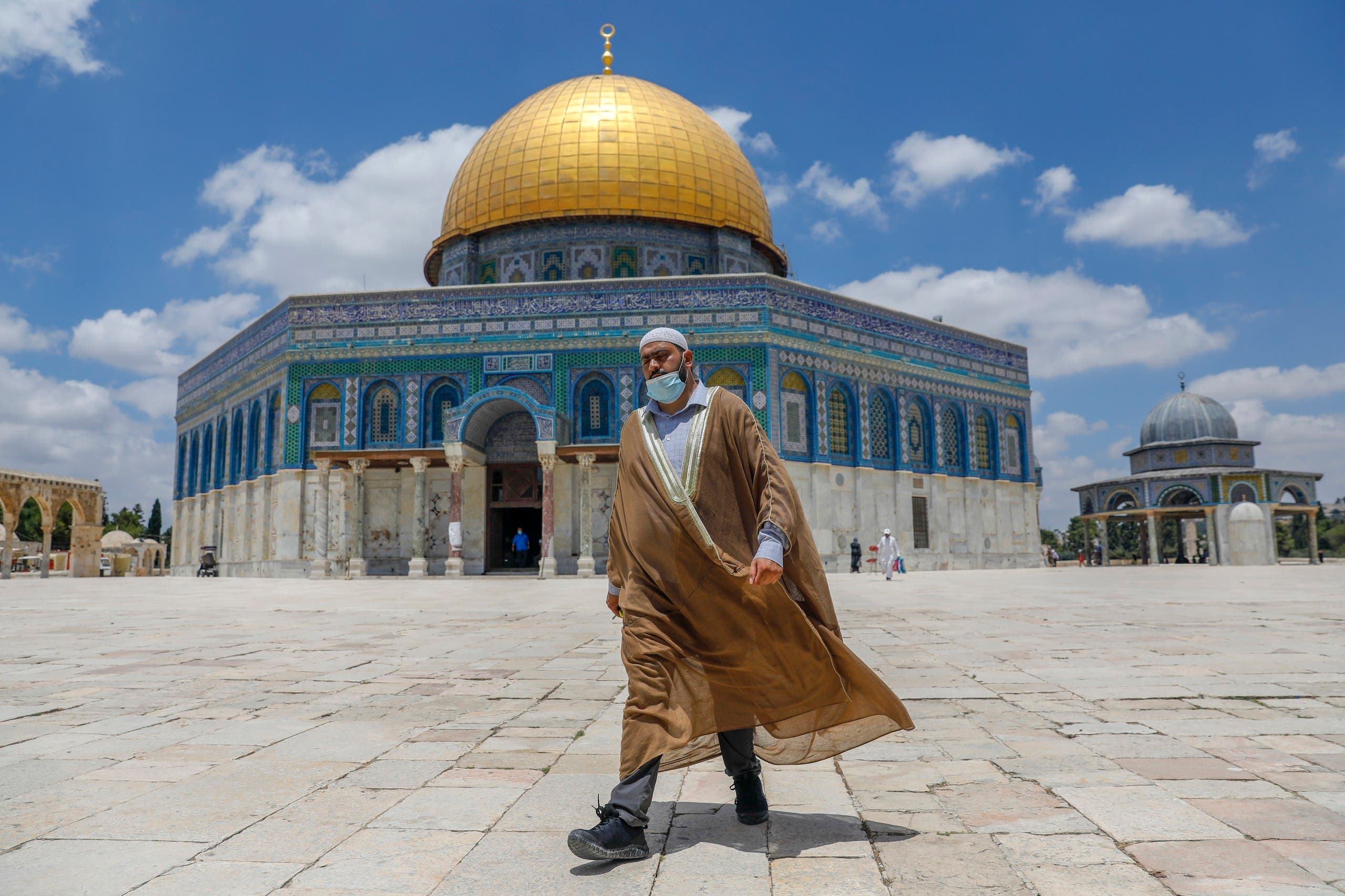 A Palestinian man walks outside the Dome of the Rock Mosque in East Jerusalem's al-Aqsa compound on July 9, 2020. (AFP)