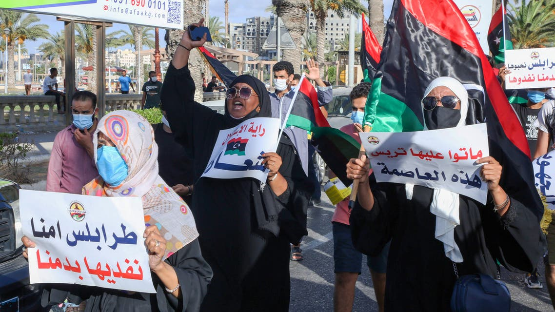 Libyans chant slogans during a demonstration due to poor public services at the Martyrs' Square at the centre of the GNA-held Libyan capital Tripoli on August 25, 2020. Angered by chronic water, power, and petrol shortages in a country with Africa's largest proven crude oil reserves, the mostly young people had marched through the city centre chanting slogans including No to corruption!