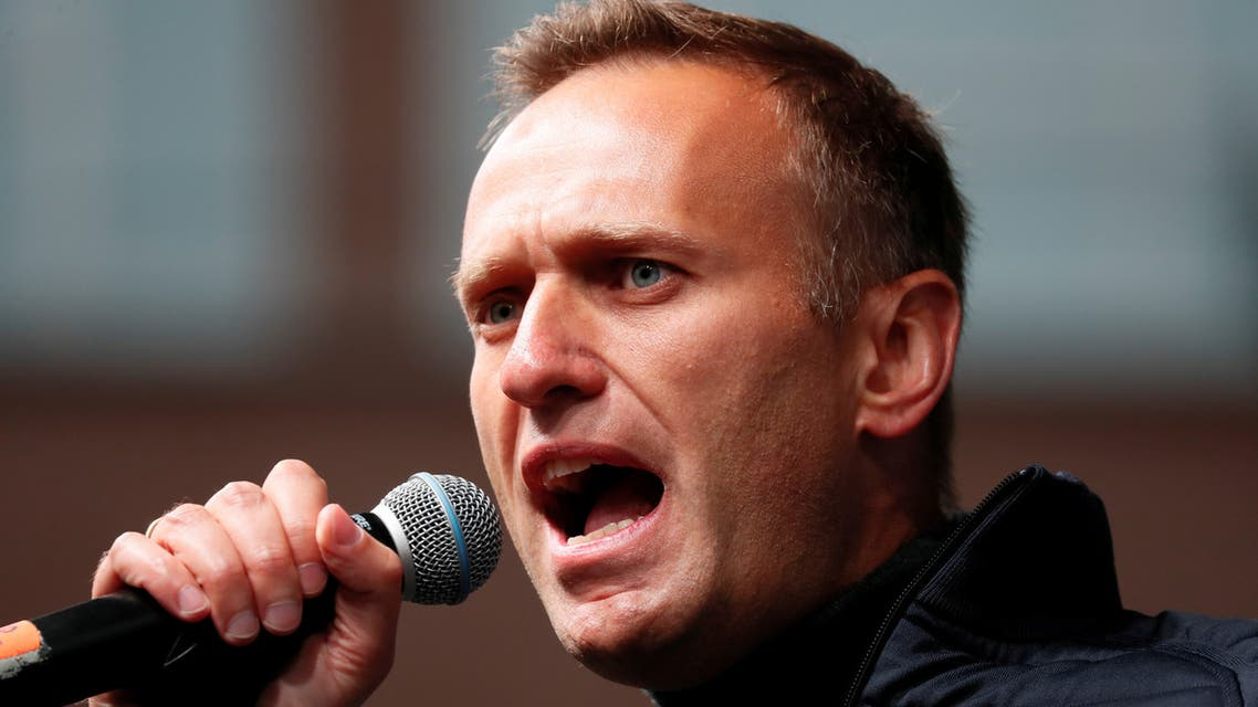FILE PHOTO: Russian opposition leader Alexei Navalny delivers a speech during a rally to demand the release of jailed protesters, who were detained during opposition demonstrations for fair elections, in Moscow, Russia September 29, 2019. REUTERS/Shamil Zhumatov/File Photo