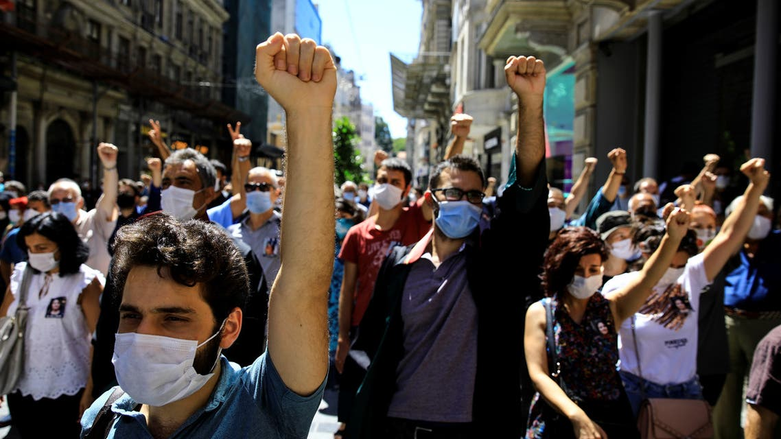 Lawyers shout slogans as they gather to commemorate Ebru Timtik, a Turkish lawyer who died while she was on hunger strike for 238 days demanding a fair trial following her conviction last year for membership in a terrorist organisation, in front of the Bar Association, in Istanbul, Turkey, August 28, 2020. REUTERS/Umit Bektas