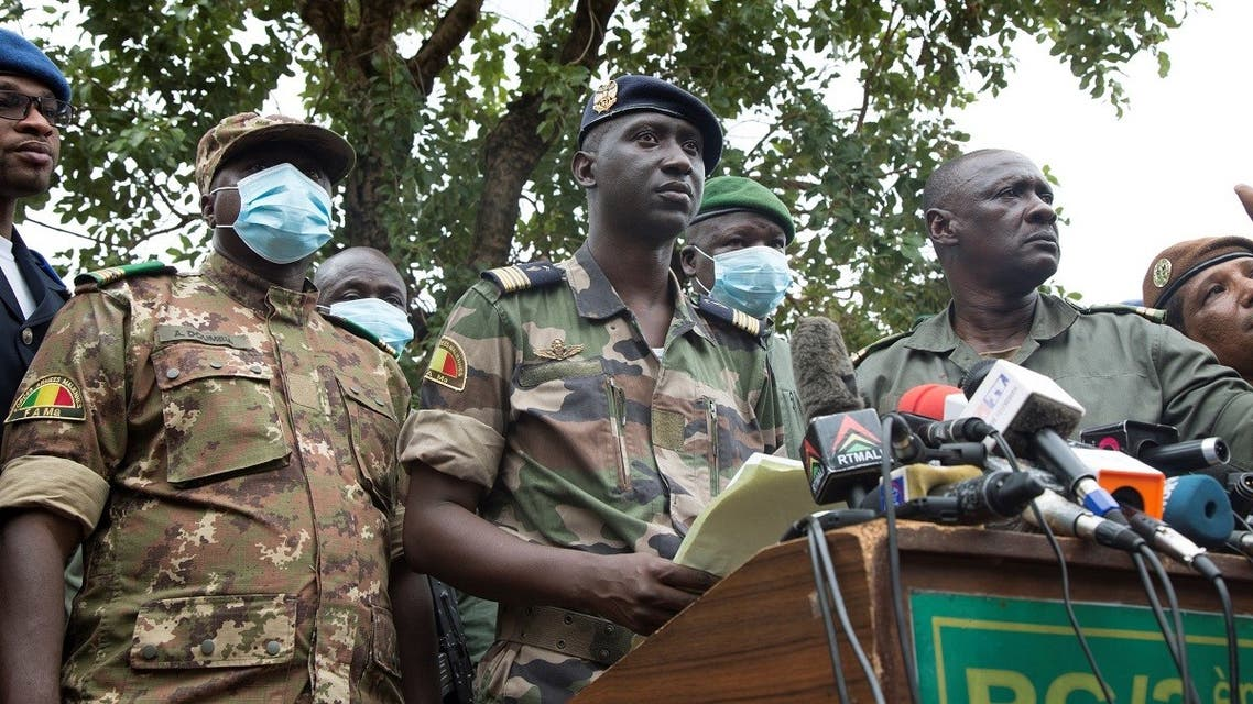 Malian Air Force deputy chief of staff and military junta spokesperson Ismael Wague (C) speaks during a press conference in Kati on August 19, 2020, a day after the military arrested Malian president Ibrahim Boubacar Keita and he officially resigned. (AFP)
