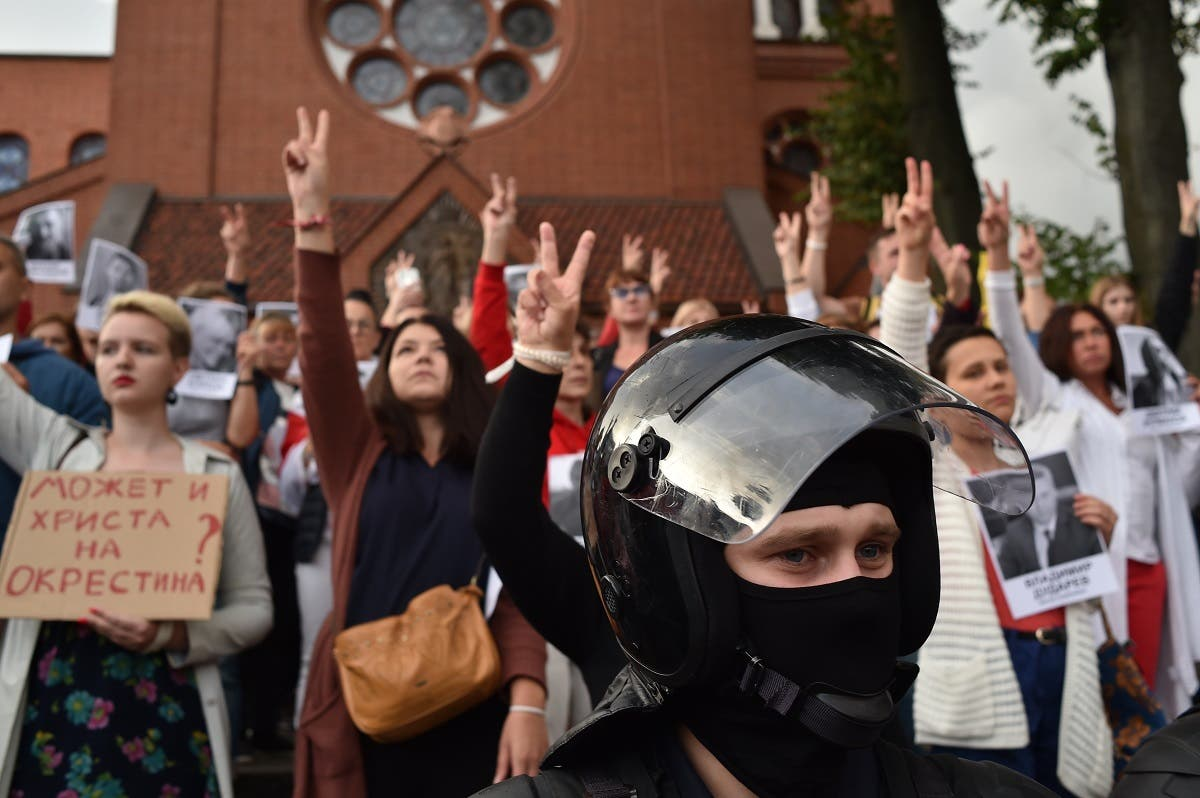 Belarus opposition supporters make Victory signs during their rally to protest against disputed presidential elections results in Minsk on August 27, 2020. (AFP)