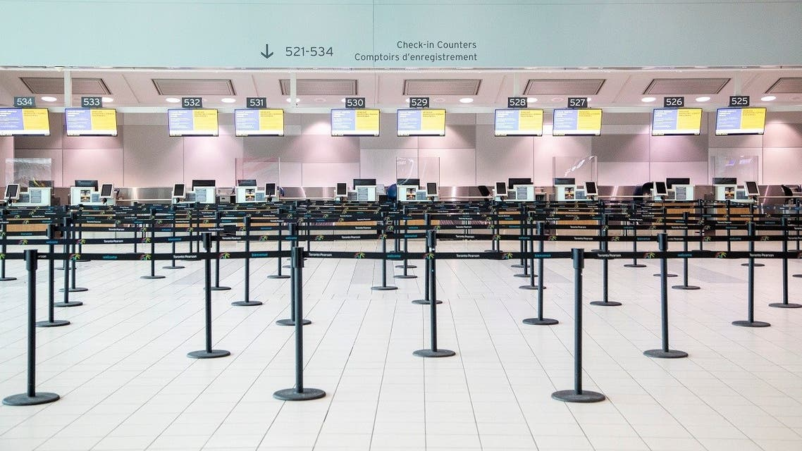 An empty check-in counter is pictured as a Healthy Airport initiative is launched for travel, taking into account social distancing protocols to slow the spread of the coronavirus disease (COVID-19) at Toronto Pearson International Airport. (Reuters)