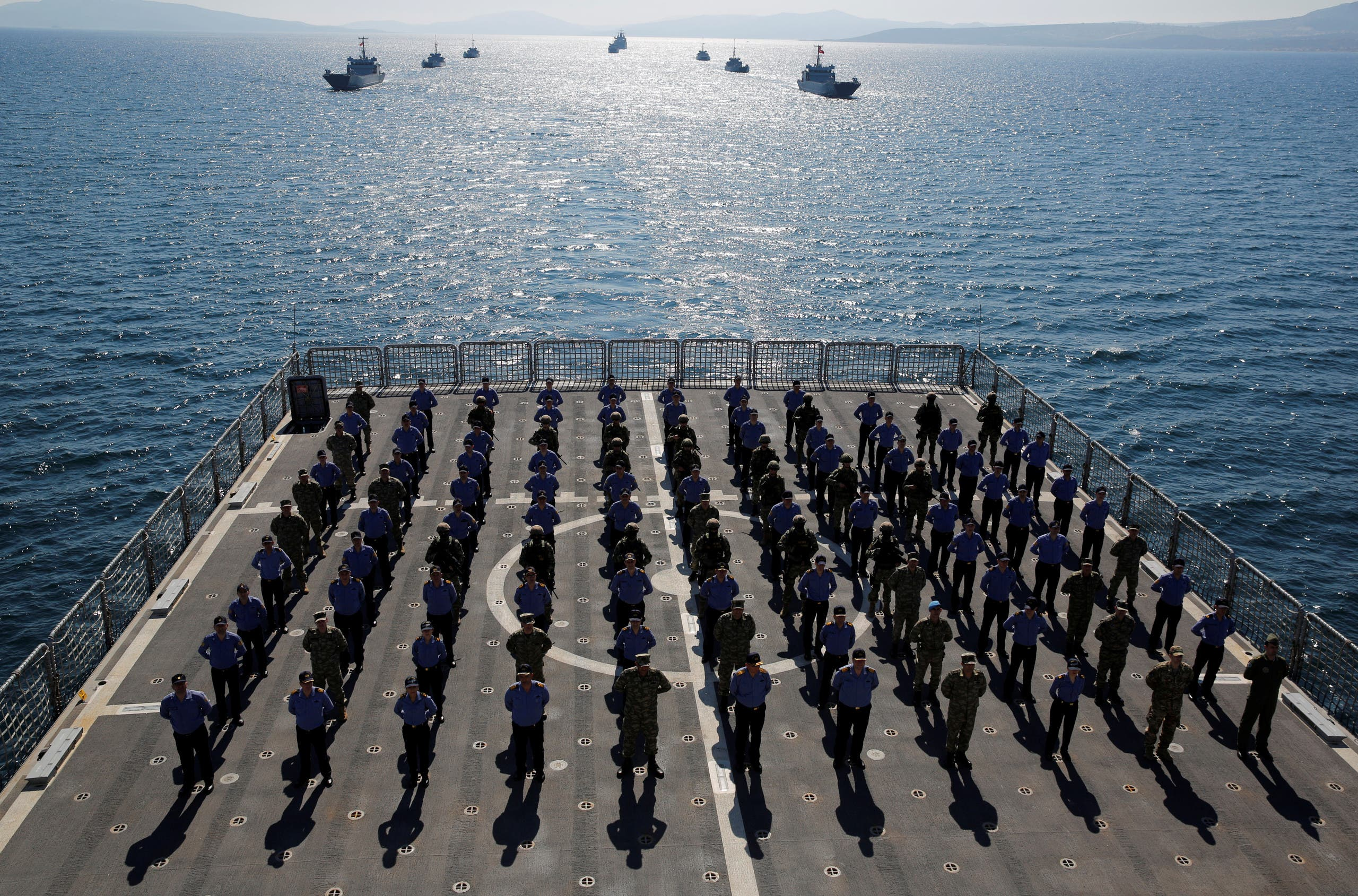 Crew members of the amphibious landing ship tank (LST) TCG Bayraktar (L-402) pose after a landing drill during the Blue Homeland naval exercise off the Aegean coastal town of Foca in Izmir Bay, Turkey. (Reuters)