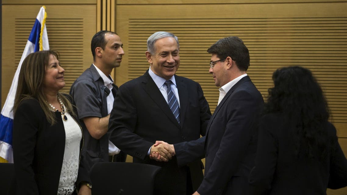 Israel's Prime Minister Benjamin Netanyahu (C) shakes hands with lawmaker Ofir Akunis (R) during a Likud party meeting at parliament in Jerusalem May 11, 2015. (Reuters)