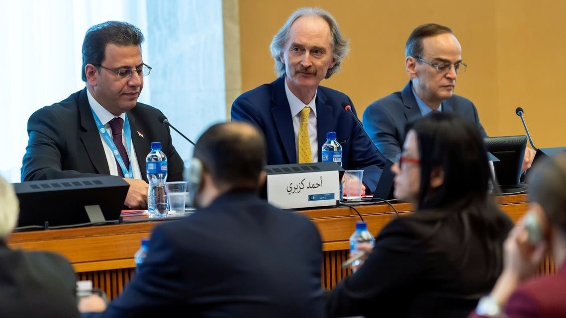 A file photo shows al-Bahra (R) with Pederson (C) and Kuzbari (L) during a meeting of the Syrian Constitutional Committee at the UN headquarters in Geneva, Switzerland October 31, 2019. (Martial Trezzini/Pool via Reuters)