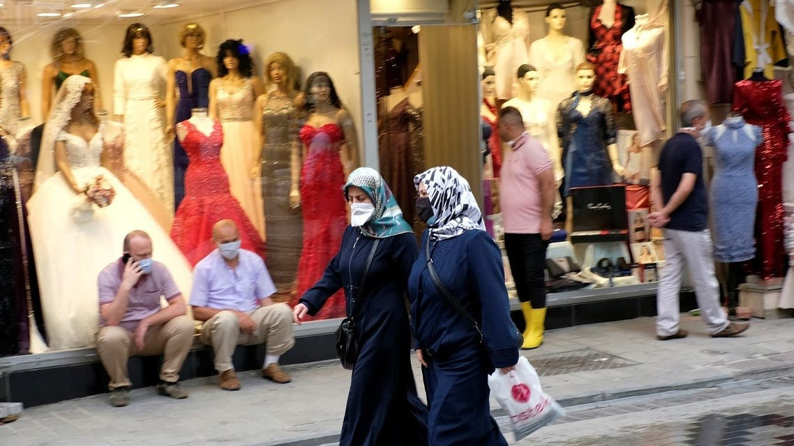 Women wearing protective face masks walk past by a shop, amid the coronavirus disease (COVID-19) outbreak, in Istanbul, Turkey June 23, 2020. (Reuters)