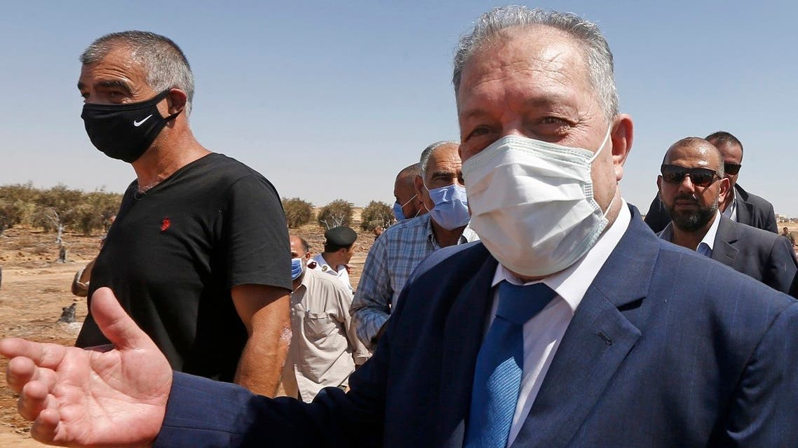 Syrian prime minister-designate, Hussein Arnous, visits on August 24 , 2020 the site of an attack on a gas pipeline near Damascus, between the areas of Adra and al-Dhamir. (AFP)
