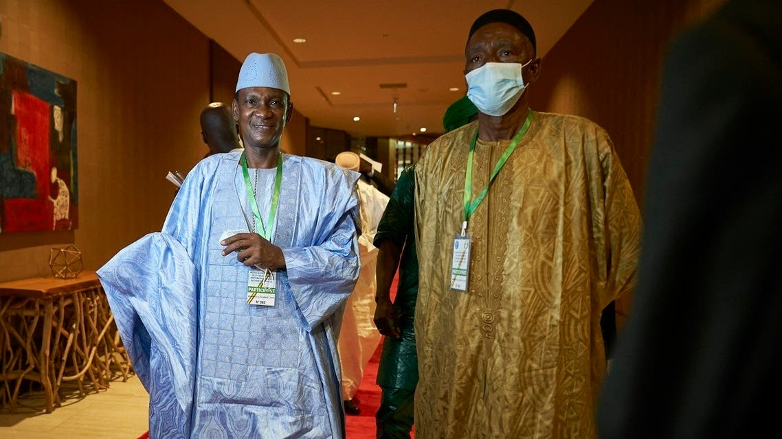 Choguel Maiga (L), a leader of the opposition coalition M5-RFP, arrives at the Sheraton hotel in Bamako on July 23, 2020. (AFP)
