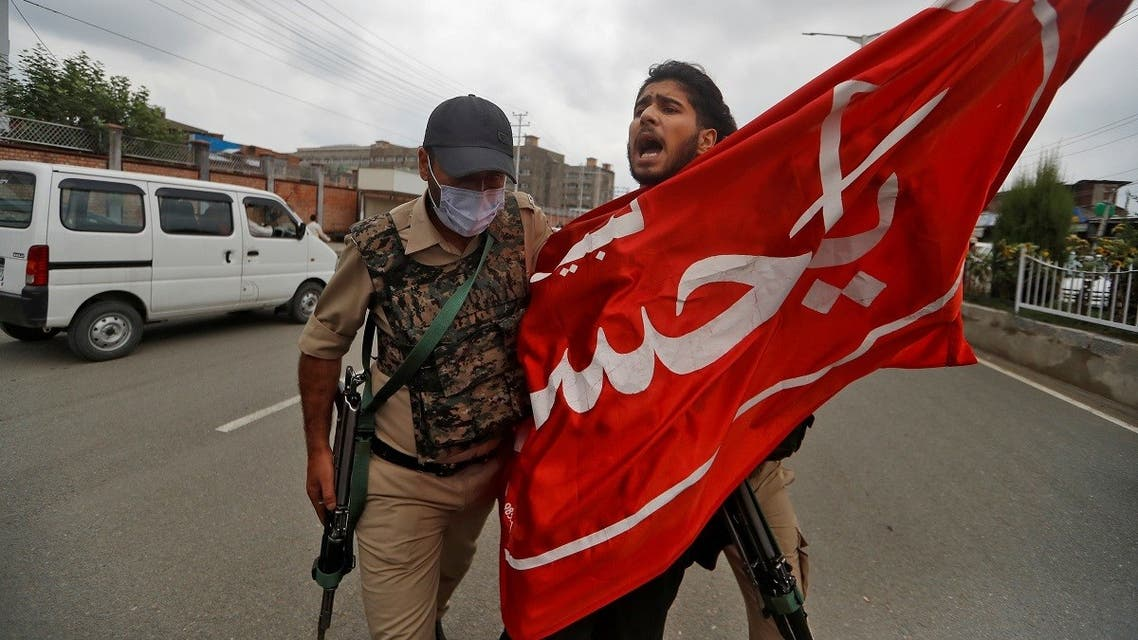 A Kashmiri Shi'ite Mulsim shouts slogans as he is detained an Indan policeman while trying to participate in a Muharram procession, in Srinagar. (Reuters)