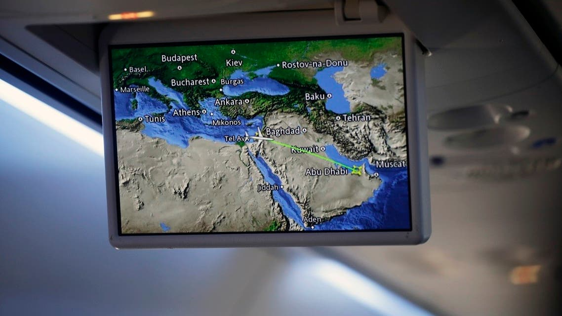 An overhead screen displays a map showing the flight route of an El Al plane from Israel en route to Abu Dhabi, United Arab Emirates, August 31, 2020. (AP)