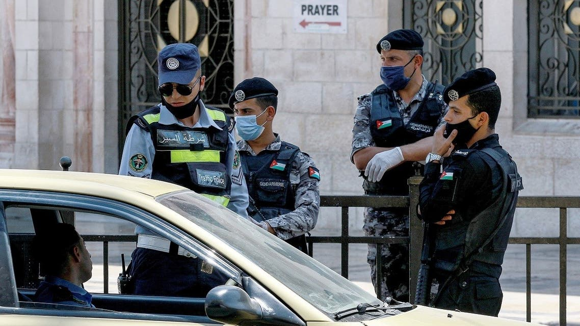 Policemen stop a vehicle outside the Grand Husseini Mosque while enforcing a curfew due to the COVID-19 coronavirus pandemic in Jordan's capital Amman on August 28, 2020. (AFP)