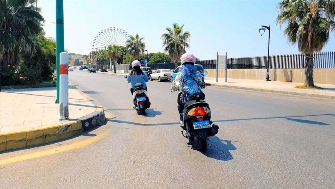 Rana and Carine Karazi, who have launched a women-only motorbike taxi service, are seen driving in Beirut, Lebanon. (Supplied)
