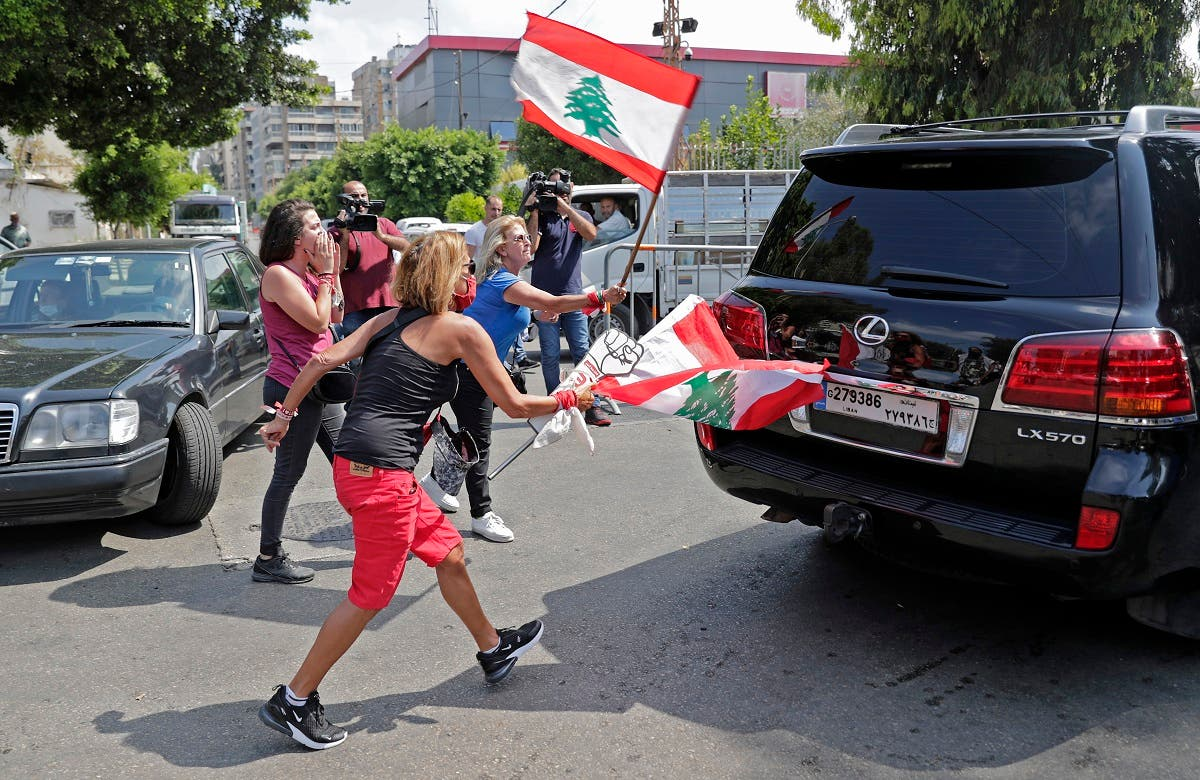 000_1WH0KQLebanese anti-government protesters attack a vehicle belonging to a member of the parliament upon his arrival to the parliamentary session at the UNESCO Palace in Beirut, on August 13, 2020. (AFP)