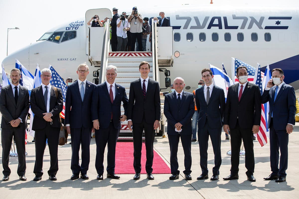 White House Adviser Jared Kushner and US National Security Adviser Robert O'Brien pose with members of the Israeli-American delegation before the departure to Abu Dhabi on August 31, 2020. (Reuters)