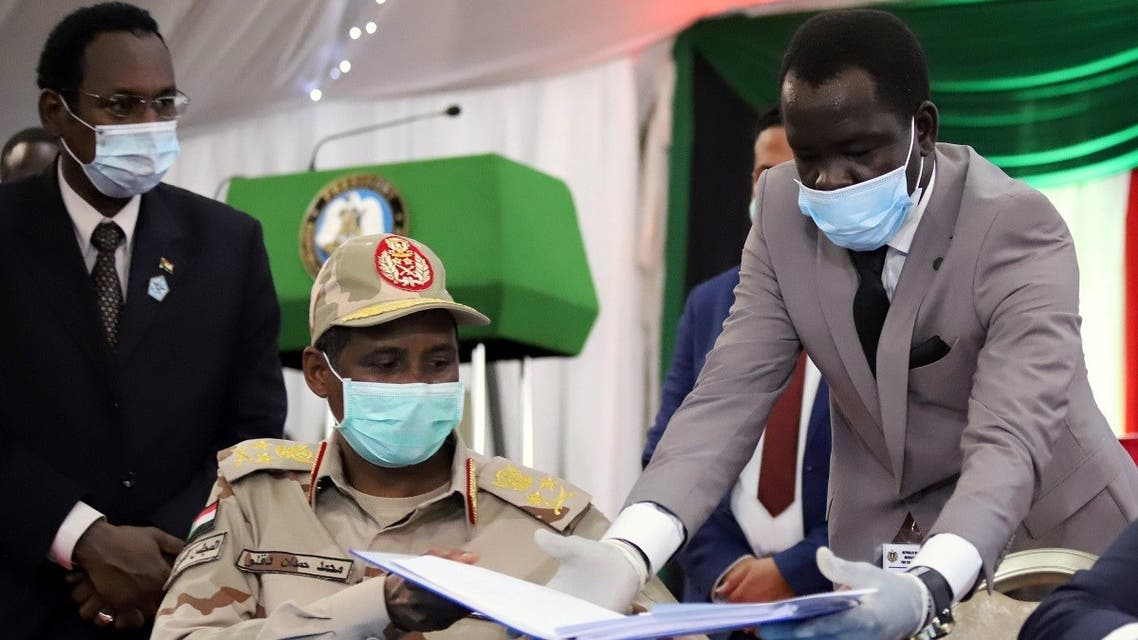 Lieutenant General Mohamed Hamdan Dagalo, deputy head of the military council and head of the RSF, reveives a peace agreement to sign between Sudan's power-sharing government and five key rebel groups. (Reuters)