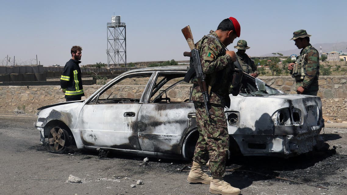 Afghan security forces inspect the exterior of a car after a suicide bomb blast in Gardez, Paktia Province, Afghanistan June 18, 2017. REUTERS/Samiullah Peiwand TPX IMAGES OF THE DAY