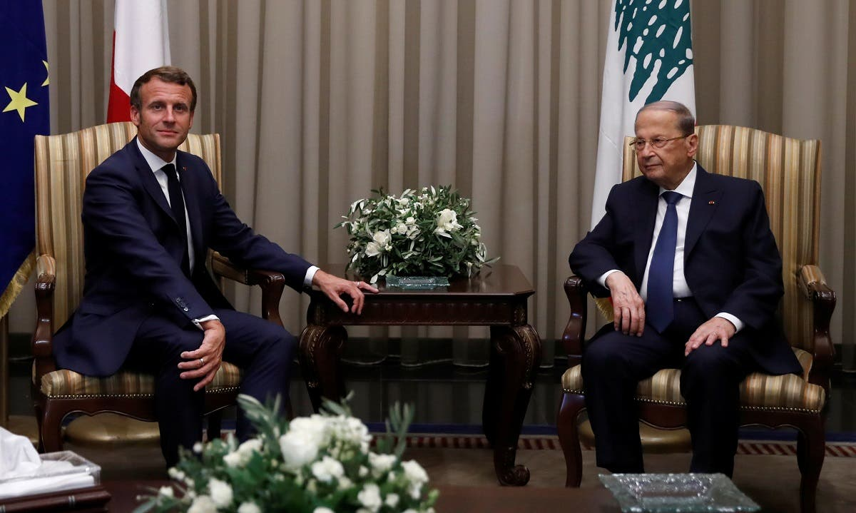Lebanese President Michel Aoun welcomes French President Emmanuel Macron at Beirut International airport, Lebanon, on August 31, 2020. (Reuters)